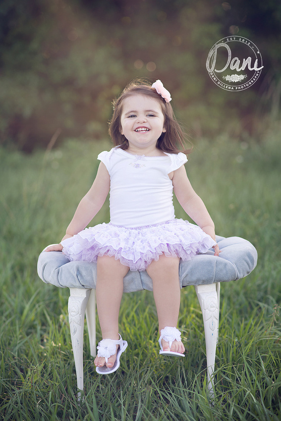 such a cute little girl modeling a big smile for mommy in florida